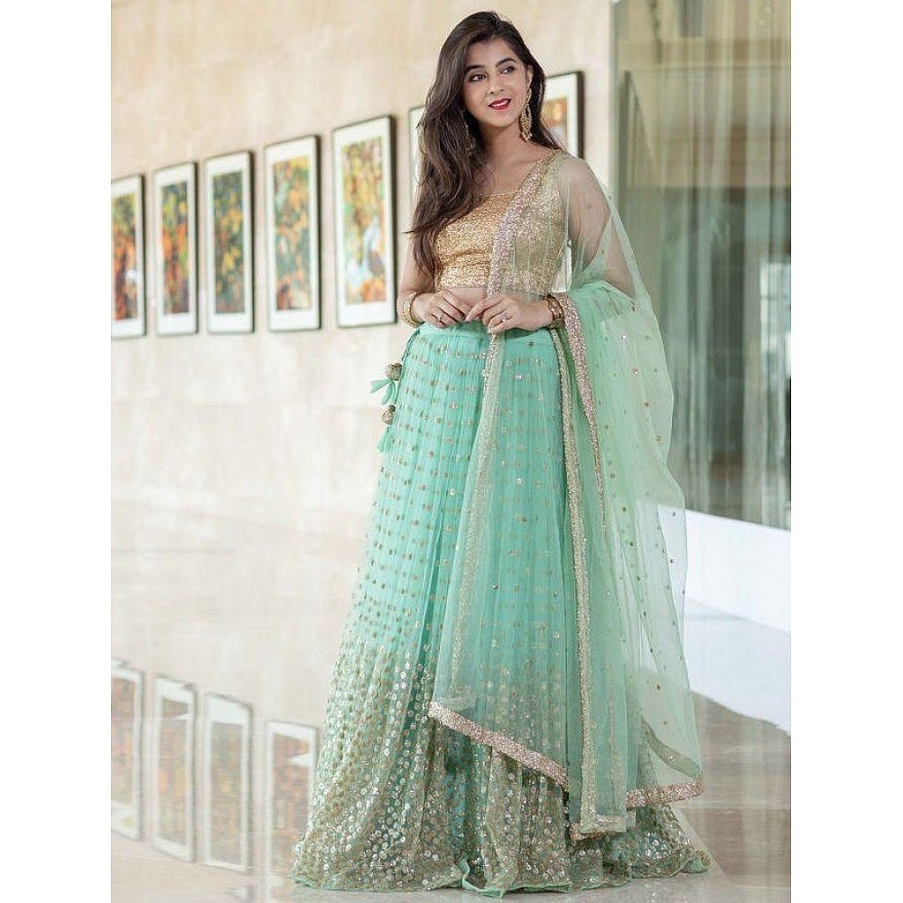Sea green net heavy sequence work wedding lehenga choli