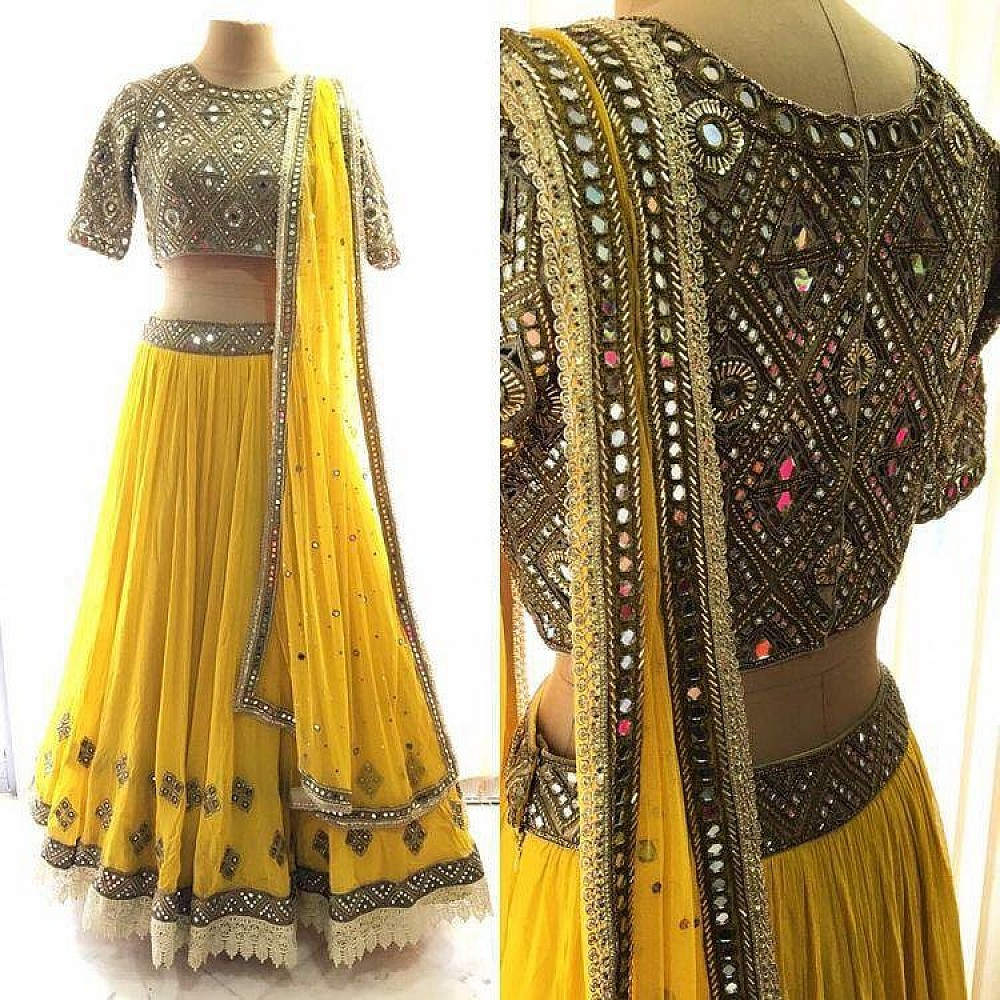 yellow georgette designer mirror work lehenga with heavy blouse