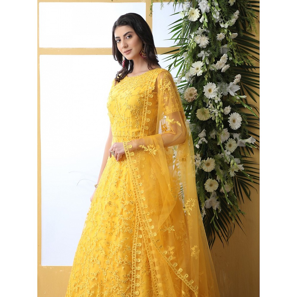 Yellow net heavy embroidered wedding long anarkali gown