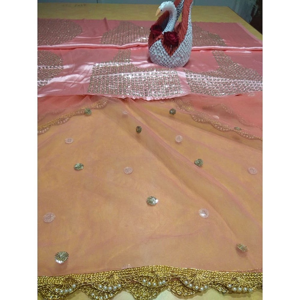 Peach soft net embroidered lehenga choli for ceremony