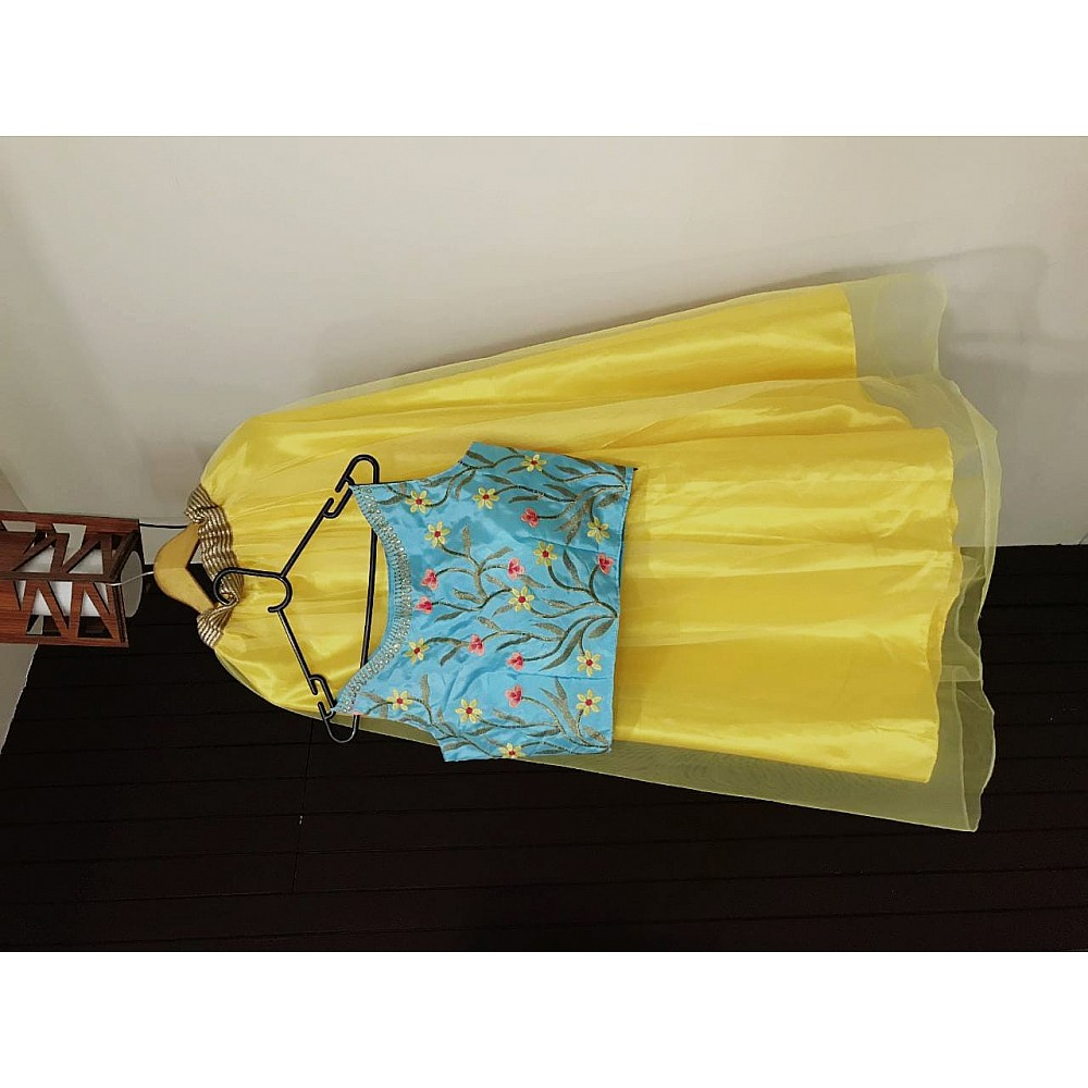 yellow net festival wear crop top lehenga with embroidered blouse