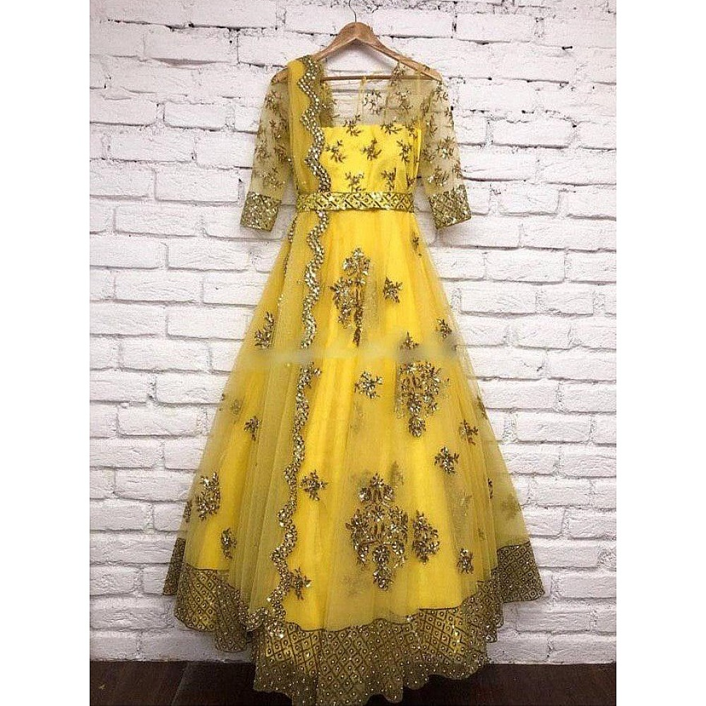 Yellow net sequence worked wedding gown with dupatta