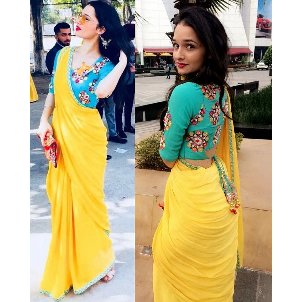yellow georgette festival wear saree with embroidered blouse