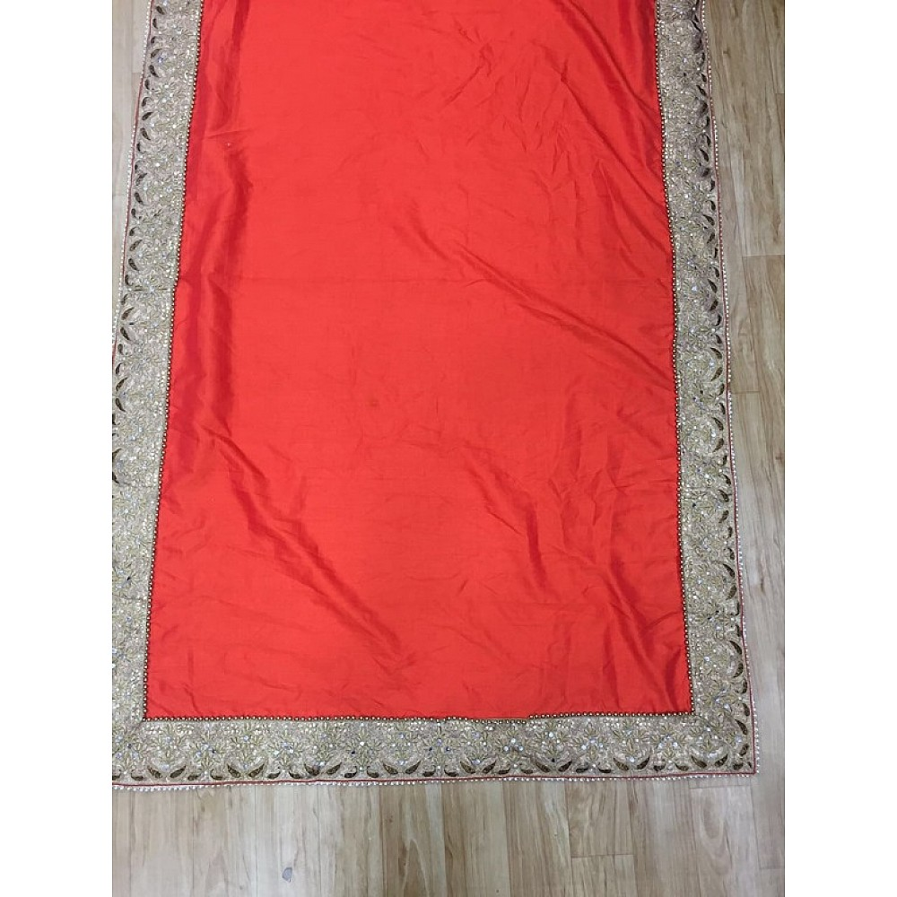 Designer embroidered orange wedding saree