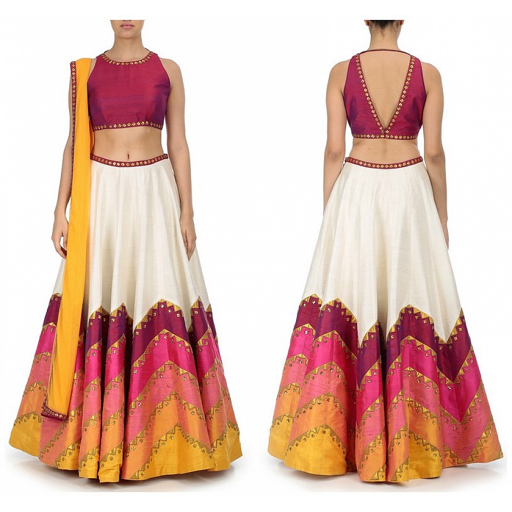 Multi colored lehenga with pink embroidered blouse and dupatta.