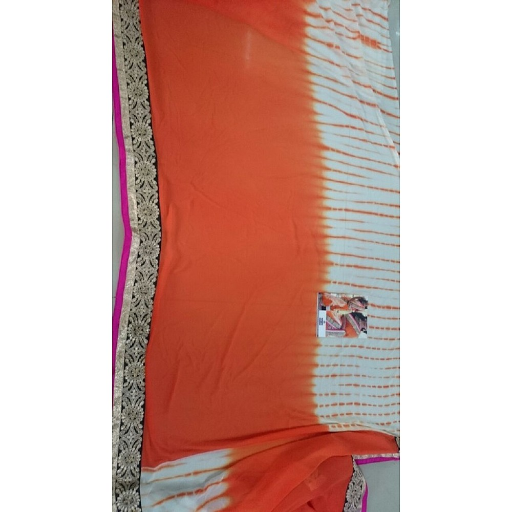 pretty look orange lace border saree with fancy blouse