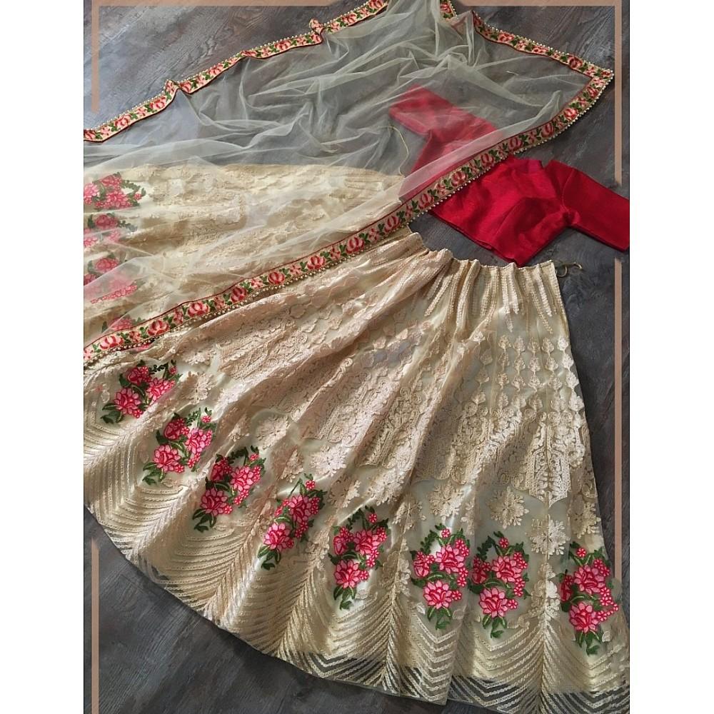 Cream net sequence embroidered ceremonial lehenga choli