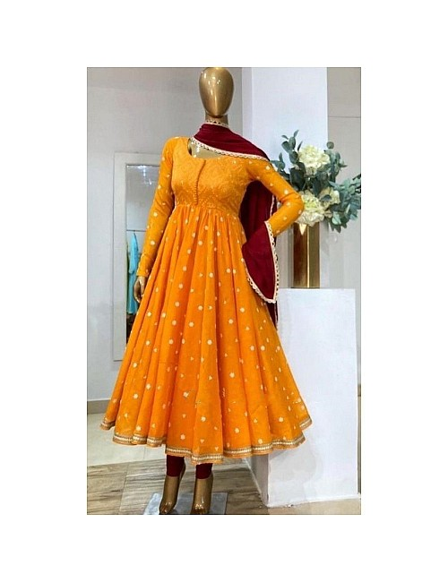 Mustard yellow heavy georgette embroidered party wear gown
