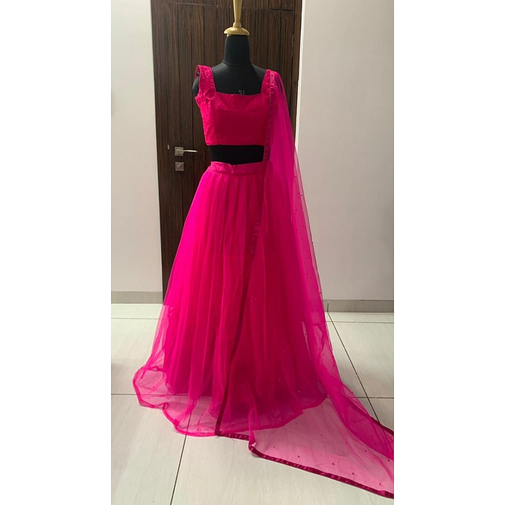 Pink two layer net pearl work lehenga choli