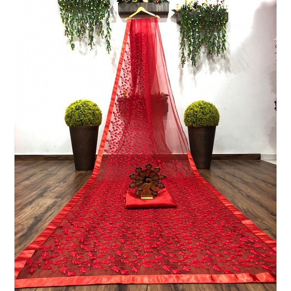 Red soft net heavy embroidered saree