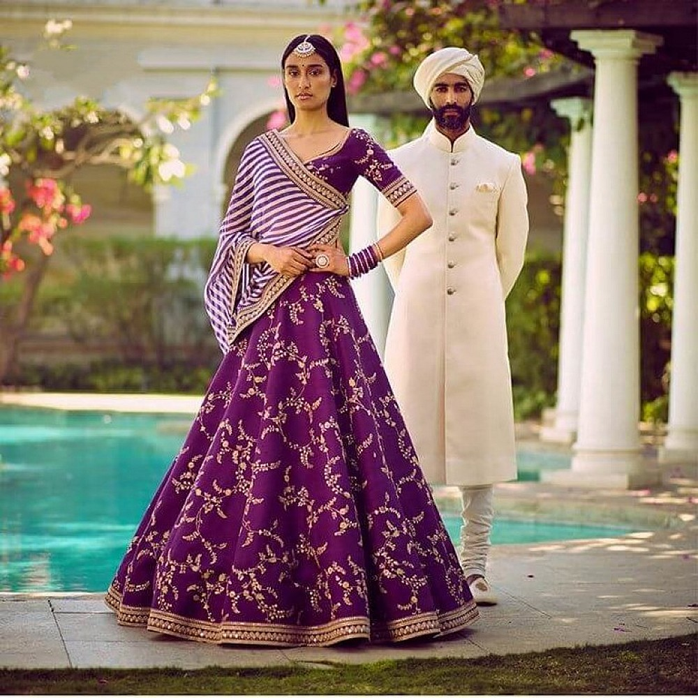 purple tapeta silk heavy embroidered wedding lehenga